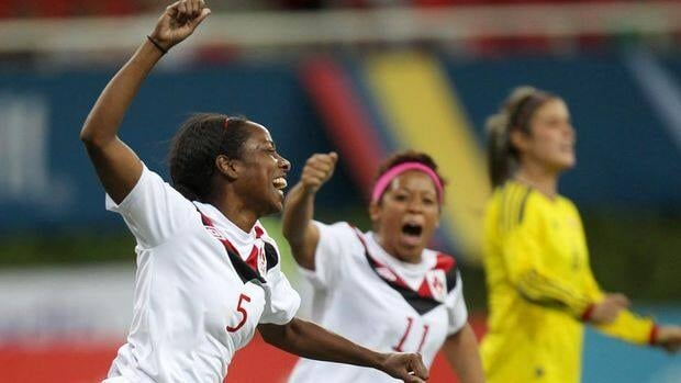 Canada's Robyn Gayle, left, celebrates her winning goal against Colombia in their semifinal match on Tuesday.
