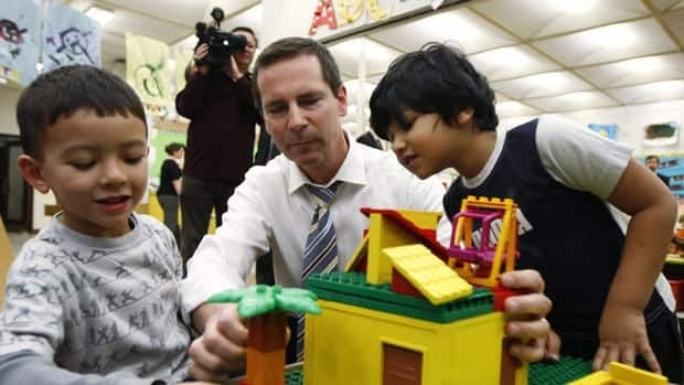 Ontario Premier Dalton McGuinty plays Lego with Toronto kindergarten students in 2009. McGuinty's government released clarified guidelines Friday on what fees the province's schools can charge students.