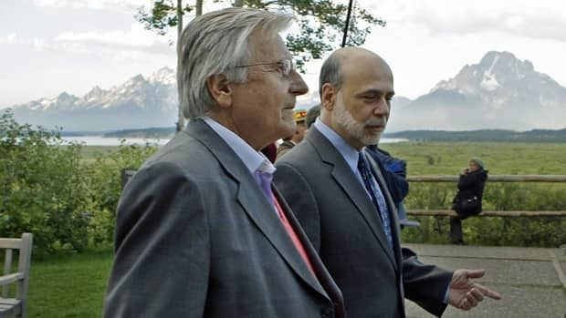 U.S. Federal Reserve chairman Ben Bernanke, right, and Jean-Claude Trichet, of France, president of the European Central Bank, take a morning stroll on the veranda of the Jackson Lake Lodge Friday.