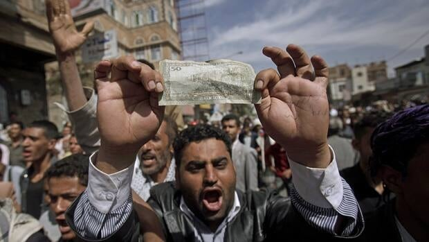 A Yemeni demonstrator demands the resignation of president Ali Abdullah Saleh in February. Fear that unrest could spread beyond Libya is pushing up oil prices and the Canadian dollar.