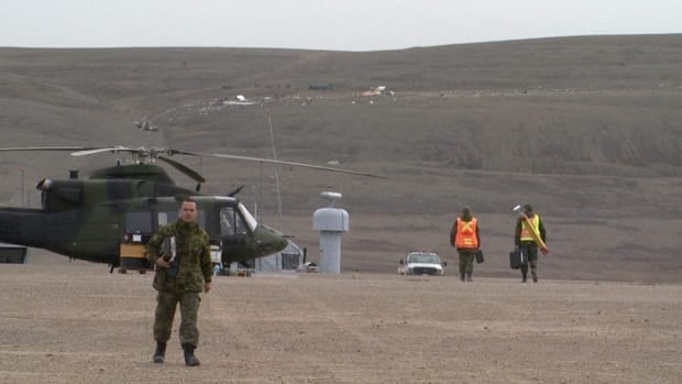 Military personnel work near the scene of the First Air crash site in Resolute Bay on Sunday.