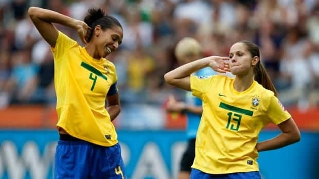 Brazil's Erika, right, dances with teammate Aline after scoring a gorgeous goal against Equatorial Guinea in the first half at the women's World Cup Wednesday in Frankfurt, Germany.