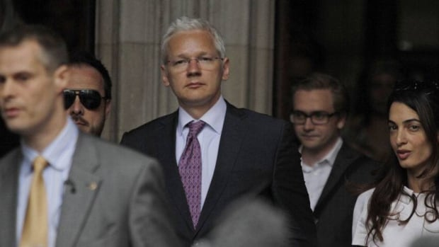 WikiLeaks founder Julian Assange, centre, leaves Britain's Royal Courts of Justice after his extradition appeal was heard in central London on July 13. Assange is living at a supporter's mansion in eastern England as he awaits a judge's decision on whether he will be extradited to Sweden over sex allegations.