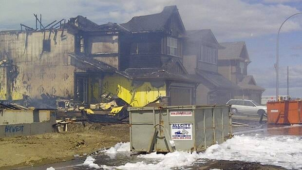 Two houses in Calgary's Auburn Bay community were destroyed Saturday by a fire that started in a house under construction.