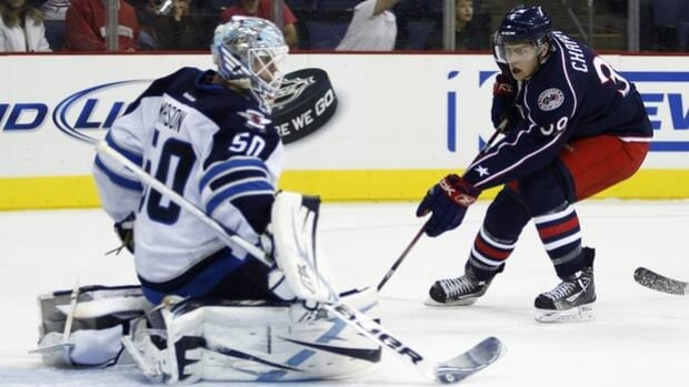 Michael Chaput (39) takes a shot on Jets netminder Chris Mason in a 5-1 Blue Jackets win at Nationwide Arena on Sept. 20.