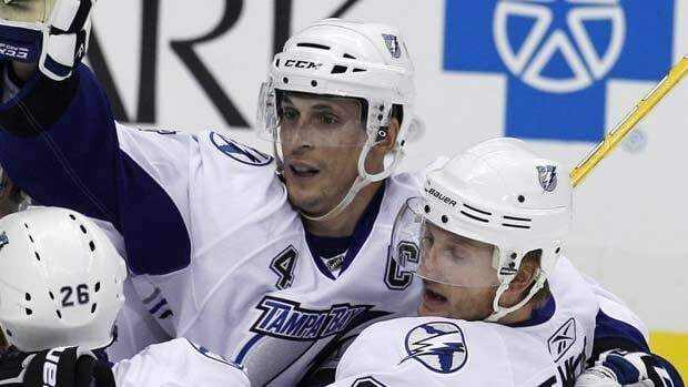 Captain Vincent Lecavalier, centre, celebrates Tampa Bay's fourth goal in Game 2 in Pittsburgh on Friday.
