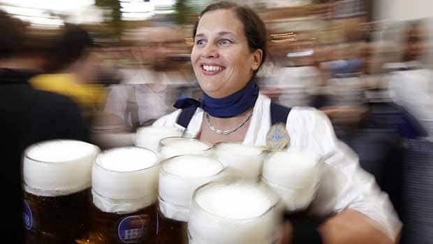 A waitress carries a load of one litre beer mugs to thirsty customers at the start of the Oktoberfest beer festival in Munich in 2010. German researchers say a 'considerable proportion' of the most common and most lethal cancers can be attributed to drinking alcohol.