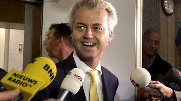 Geert Wilders of the Freedom Party leaves a courtroom in Amsterdam on Thursday after his acquittal.