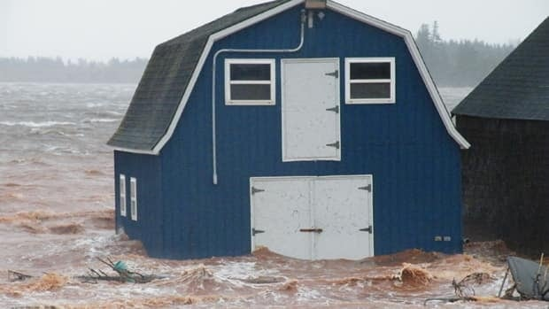 A storm surge on Dec. 21 swamped a number of buildings, including this barn in Long River.