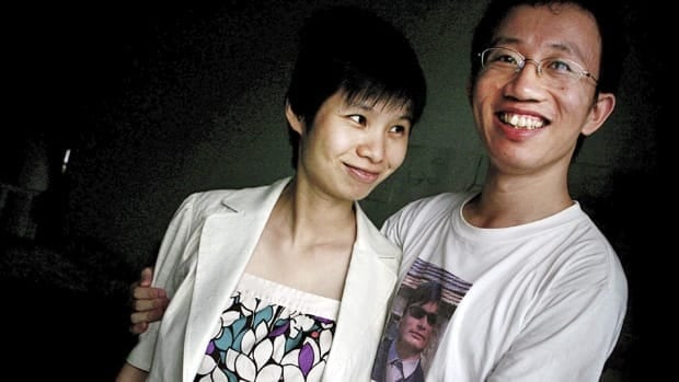 In this 2007 file photo, Hu Jia, right, and Zeng Jinyan, husband-and-wife activists, pose for a picture at their home in Beijing. Hu, who was jailed for sedition more than three years ago, has been released from prison, his wife said.