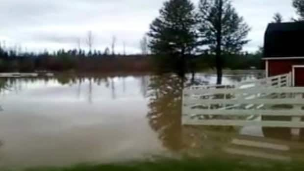 Flooding on Norm Peterson's acreage outside Slave Lake, Alta. started early Friday morning.