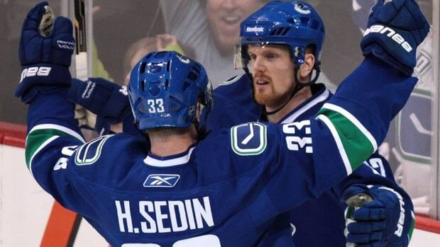 If Vancouver's Daniel Sedin, right, wins this year's Hart Trophy, he will have followed in the footsteps of brother Henrik, left, who claimed the honour last season.