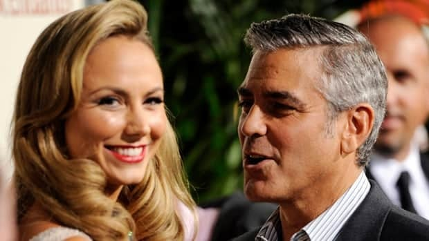 George Clooney, right, and girlfriend Stacy Keibler at the premiere of The Descendants in November: The film won best picture honours at the Los Angeles Film Critics Awards on Sunday night. Chris Pizzello/Associated Press