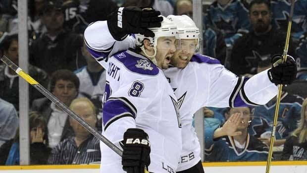 Drew Doughty, left, celebrates with Jack Johnson after the latter scored for the Los Angeles Kings in Game 2 in San Jose on Saturday.