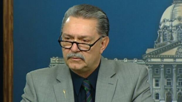 Alberta Health Minister Gene Zwozdesky speaks to reporters at a news conference in Edmonton Friday.