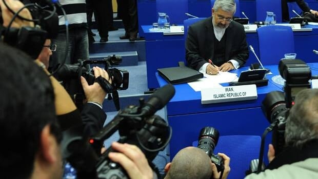 The Iranian ambassador to the International Atomic Energy Agency, Ali Asghar Soltanieh, reviews documents before the opening of the board of governors conference in Vienna on Friday.