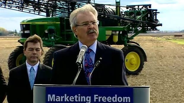 Agriculture Minister Gerry Ritz speaks to reporters about the proposed changes to Canada's grain marketing system at a farm outside Stittsville, Ont., on Tuesday.