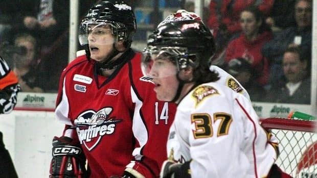 IceDogs forward Tom Kuhnhackl, left, pictured when he was a member of the Windsor Spitfires, was suspended 20 games by the OHL on Tuesday for leveling Rangers defenceman Ryan Murphy last week.