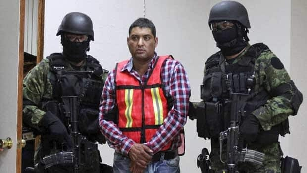 Soldiers escort Carlos Oliva Castillo in Mexico City on Oct. 13, 2011. Defense Department spokesman Ricardo Trevilla said Oliva Castillo is a top figure in the Zetas drug cartel and was in charge of the cartel's operations in the key northern states of Tamaulipas, Coahuila and Nuevo Leon.