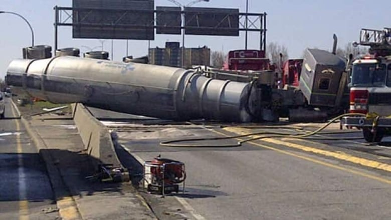 Tanker truck pins car in major Brossard accident | CBC News