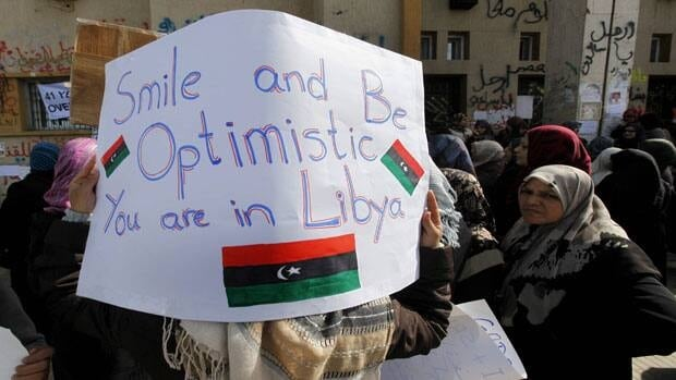 Anti-Gadhafi protesters wave a giant Libyan flag during protests in Benghazi on Feb. 28.