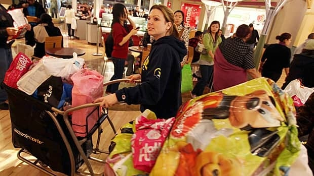Laura Jarvi of Windsor, Ont., looks for bargains at the Black Friday sales at Great Lakes Crossing Outlets in Auburn Hills, Mich., on Nov. 26, 2010.