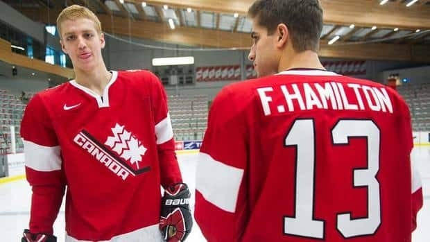 Dougie Hamilton, left, and brother Freddie (13) chat during the annual Team Canada photograph after the naming of the final 22-man roster on Wednesday.