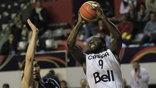 Canada's Denham Brown, right, goes to the basket against Uruguay's Nicolas Borsellino during a FIBA Americas Championship basketball game in Mar del Plata, Argentina, Wednesday, Sept. 7, 2011.