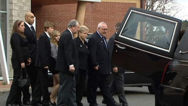 Jamie Hubley's family and hundreds of mourners gathered at Holy Redeemer Roman Catholic Church in Ottawa.