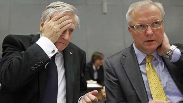 European Central Bank president Jean-Claude Trichet, left, and European Commissioner for the Economy, Olli Rehn, wait for the start of a meeting of the European Stability Mechanism in Luxembourg on Monday.