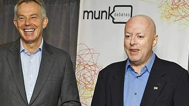 Christopher Hitchens, right, and former British prime minister Tony Blair laugh before their debate on religion at the Munk Debates in Toronto Nov. 26, 2010.