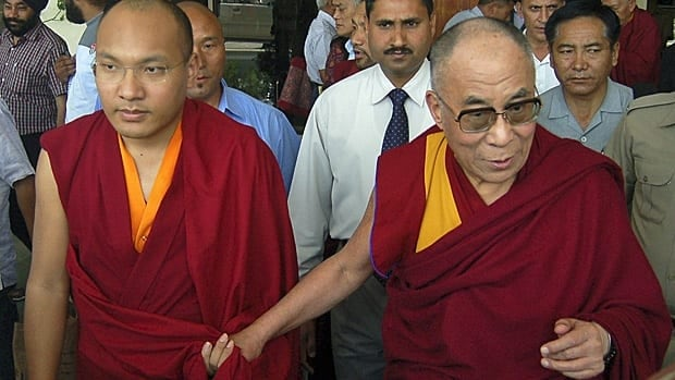Karmapa Lama, known as Ugyen Thinley Dorje, and Tibet's exiled spiritual leader the Dalai Lama in northern India in May 2011. Karmapa Lama is generally considered the successor to the Dalai Lama. (Reuters)