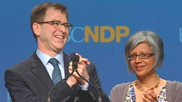 Adrian Dix and his wife, Renee Saklikar, on stage after Dix won the B.C. NDP leadership Sunday. (CBC)