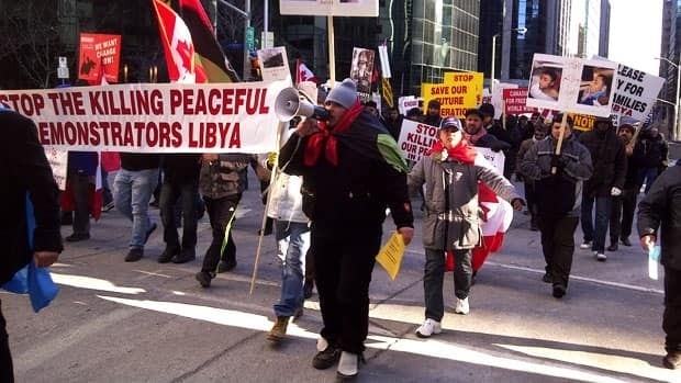 Demonstrators marched from the Libyan Embassy to Parliament Hill Tuesday to call again for Moammar Gadhafi's resignation.