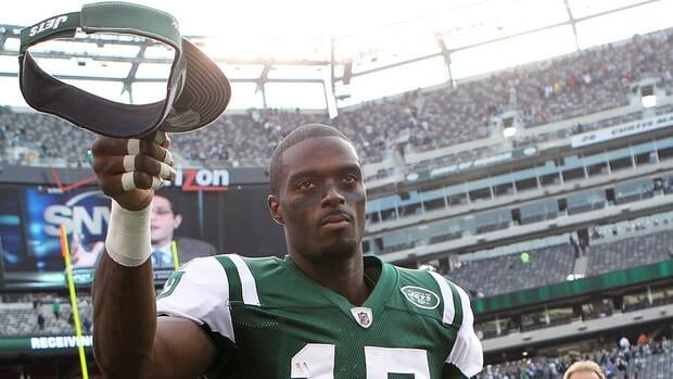 Plaxico Burress of the New York Jets tips his hat to the crowd after the game against the San Diego Chargers at MetLife Stadium on October 23, 2011 in East Rutherford, New Jersey.