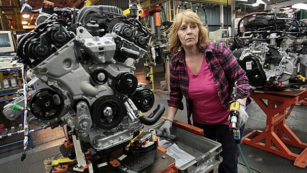 A worker at Chrysler's Windsor, Ont., assembly plant is shown. Canadian employment rebounded more quickly in 2010 than it did in past recessions, Statistics Canada said Wednesday. (Rebecca Cook/Reuters)