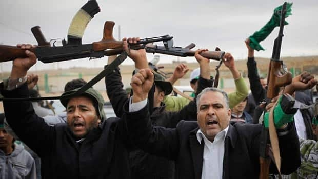 Pro-Gadhafi fighters raise their weapons in Bin Jawwad, 560 kilometres southeast of the Libyan capital Tripoli.