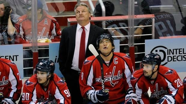 Washington Capitals head coach Dale Hunter, top, and Washington Capitals left wing Alex Ovechkin (8), look up during the first period against the St. Louis Blues on Tuesday in Washington.