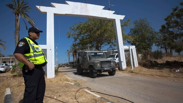 An Israeli policeman stands at the entrance to the site where an Israeli man was killed in the northern Jordan Valley on Friday. Palestinians wielding axes and iron bars killed an Israeli man outside his home in the West Bank, Israeli police said, the latest in a series of attacks on Israelis in the area.