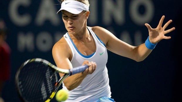 Canada's Eugenie Bouchard beat Barbora Zahlavova Strycova of the Czech Republic 2-6, 6-4, 6-1 in their last-eight tie Friday to advance to the Japan Open semifinals.