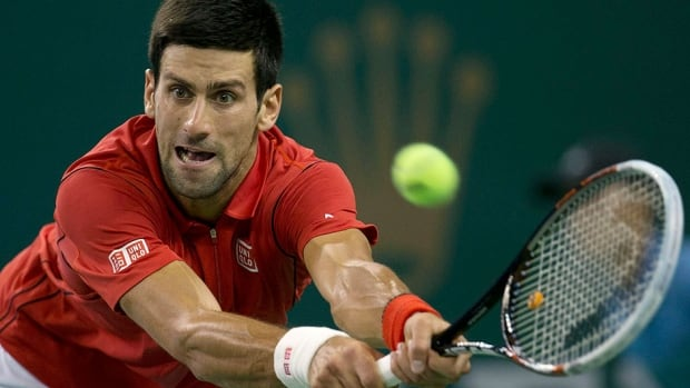 Serbia's Novak Djokovic returns a shot against France's Gael Monfils during their quarter-final match Friday in Shanghai, China. Djokovic won 6-7, 6-2, 6-4.