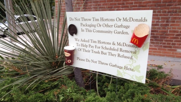 Emil Glassbourg posted a sign to inform his neighbours about the state of the community garden