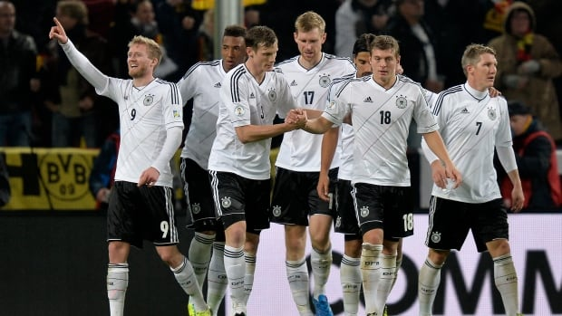 Germany's Andre Schuerrle, left, celebrates with his teammates after scoring his side's second goal against Ireland in Cologne, Germany on Friday.