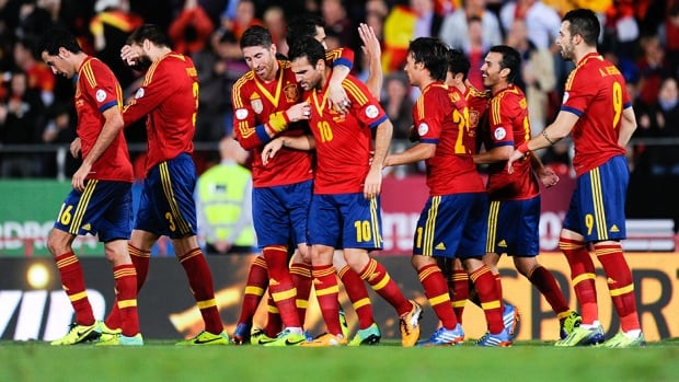 Spain players celebrate after Xavi Hernandez scored the opening goal against Belarus at Iberostars Stadium on October 11, 2013 in Palma de Mallorca, Spain.