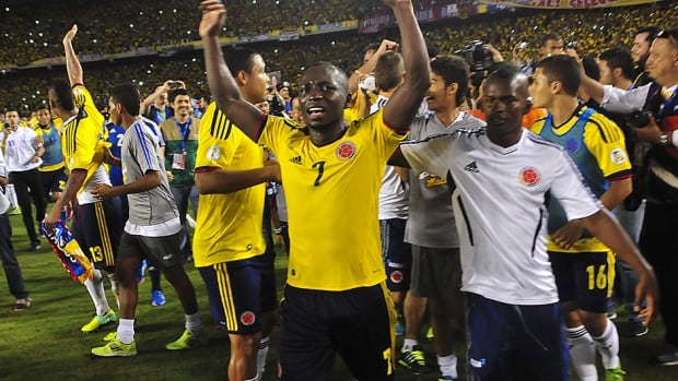 Colombia's Pablo Armero celebrates after qualifying for the Brazil 2014 FIFA World Cup.