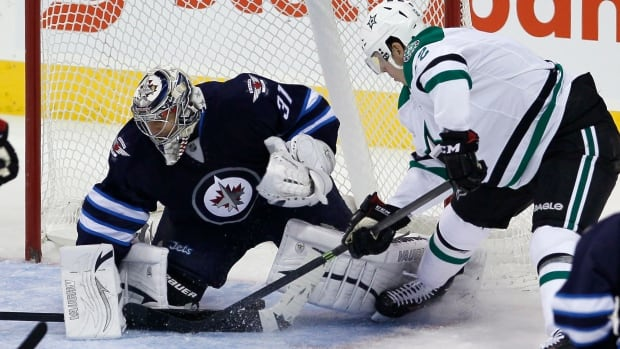 The Dallas Stars' Alex Chiasson scores on Winnipeg Jets goalie Ondrej Pavelec during the first period at the MTS Centre on Oct. 11. The Jets lost the game 4-1.