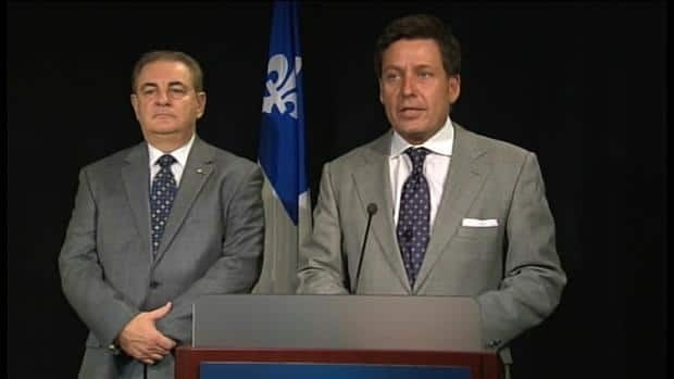 Jacques Duchesneau, left, will appear before a National Assembly committee next week. He met with transporation minister Pierre Moreau, right, in advance of that appearance.
