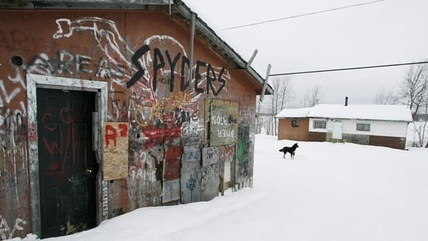 An abandoned house, which was taken over by some teens to use as a clubhouse for pool and poker, is seen on the Pikangikum First Nation in January 2007. Most homes in the community have no running water or indoor toilets, and many are dilapidated.