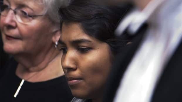 Jane Gomes, centre, arrives at court in Halifax on Wednesday.