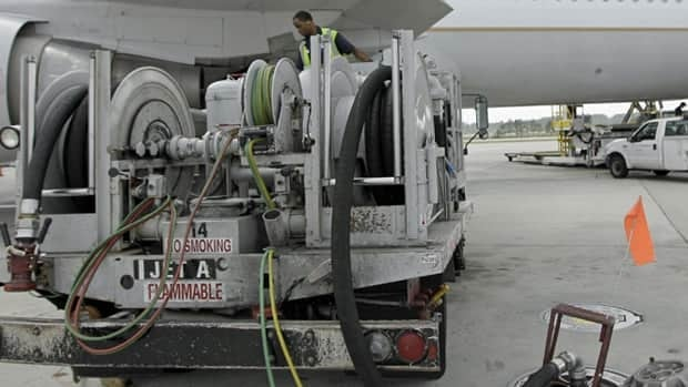 A Continental Airlines plane is fueled in Houston in April. Rising oil prices have forced IATA to revise its profit outlook.(David J. Phillip/Associated Press)
